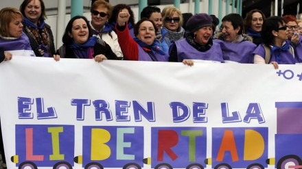 "Women pose with a banner that reads ""El tren de la libertad"" (the Freedom Train) as they prepare to leave from Gijon, northern Spain, to Madrid"